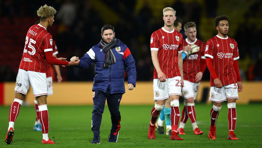 WATFORD, ENGLAND - JANUARY 06:  Lee Johnson, manager of Bristol City celebrates with Lloyd Kelly of Bristol City after The Emirates FA Cup Third Round match between Watford and Bristol City at Vicarage Road on January 6, 2018 in Watford, England.  (Photo by Julian Finney/Getty Images)