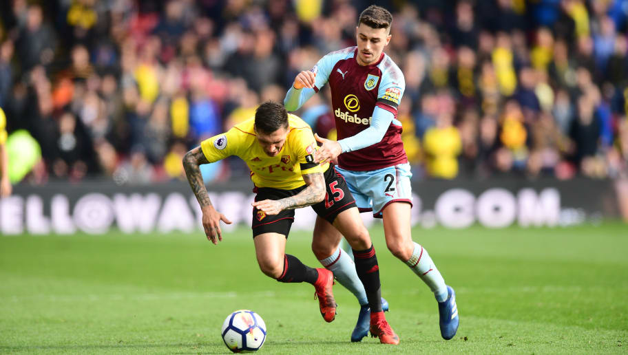 WATFORD, ENGLAND - APRIL 07:  Jose Holebas of Watford is challenged by Matthew Lowton of Burnley during the Premier League match between Watford and Burnley at Vicarage Road on April 7, 2018 in Watford, England.  (Photo by Alex Broadway/Getty Images)
