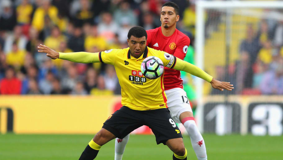 WATFORD, ENGLAND - SEPTEMBER 18:  Troy Deeney of Watford (L) and Chris Smalling of Manchester United (R) battle for possession during the Premier League match between Watford and Manchester United at Vicarage Road on September 18, 2016 in Watford, England.  (Photo by Richard Heathcote/Getty Images)