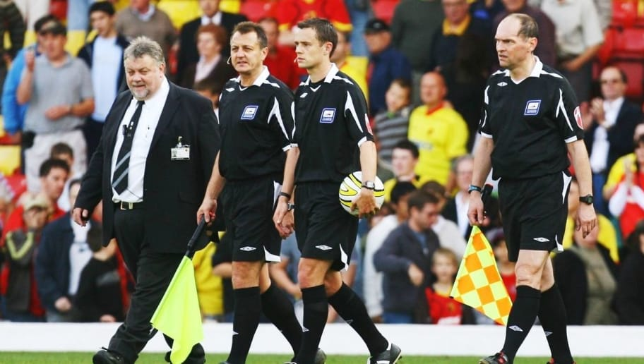 WATFORD - UNITED KINGDOM - SEPTEMBER 20: Referee Stuart Attwell (2nd L) and his assistants leave the pitch after the Coca-Cola Football League Championship match between Watford and Reading at Vicarage Road Stadium September 20, 2008  in Watford, England. (Photo Ian Walton/Getty Images)
