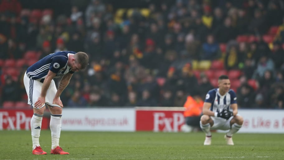 WATFORD, ENGLAND - MARCH 03: Chris Brunt and Kieran Gibbs of West Bromwich Albion react after the defeat in the Premier League match between Watford and West Bromwich Albion at Vicarage Road on March 3, 2018 in Watford, England. (Photo by Matthew Ashton/Getty Images)