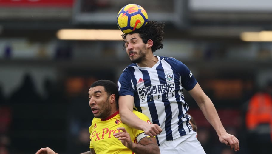 WATFORD, ENGLAND - MARCH 03: Ahmed Hegazy of West Bromwich Albion and Troy Deeley of Watford during the Premier League match between Watford and West Bromwich Albion at Vicarage Road on March 3, 2018 in Watford, England. (Photo by Matthew Ashton/Getty Images)