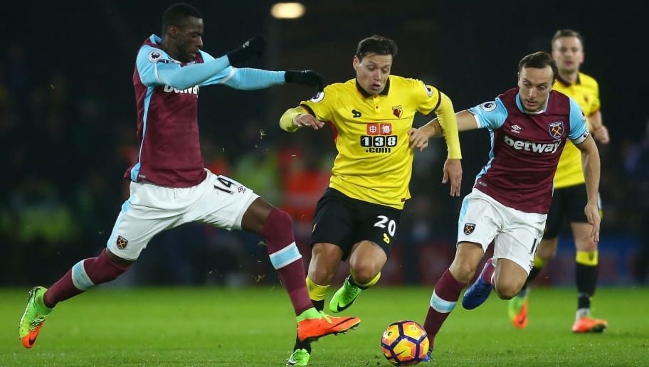 WATFORD, ENGLAND - FEBRUARY 25:  Mauro Zarate of Watford goes between Pedro Obiang and Mark Noble of West Ham United during the Premier League match between Watford and West Ham United at Vicarage Road on February 25, 2017 in Watford, England.  (Photo by Jordan Mansfield/Getty Images)