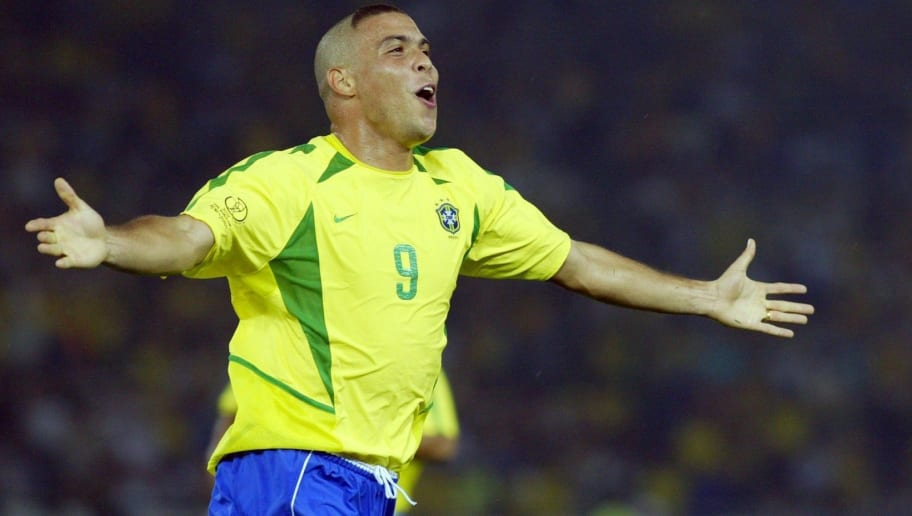 Brazil's forward Ronaldo celebrates after scoring the second goal against Germany during match 64 of the 2002 FIFA World Cup Korea Japan final 30 June, 2002 in Yokohama, Japan. Brazil won the championship 2-0, having now won a record five World Cup titles.AFP PHOTO GABRIEL BOUYS        (Photo credit should read GABRIEL BOUYS/AFP/Getty Images)