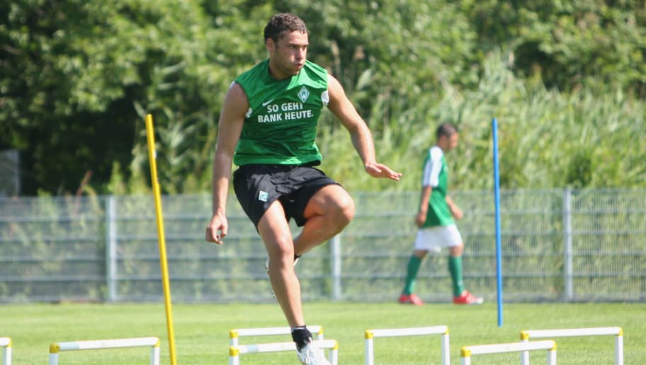 NORDERNEY, GERMANY - JULY 05: Dusco Tosic of Bremen is seen in action during the Werder Bremen training session on training ground 'An der Muehle' on July 5, 2009 in Norderney, Germany.  (Photo by Joern Pollex/Bongarts/Getty Images)