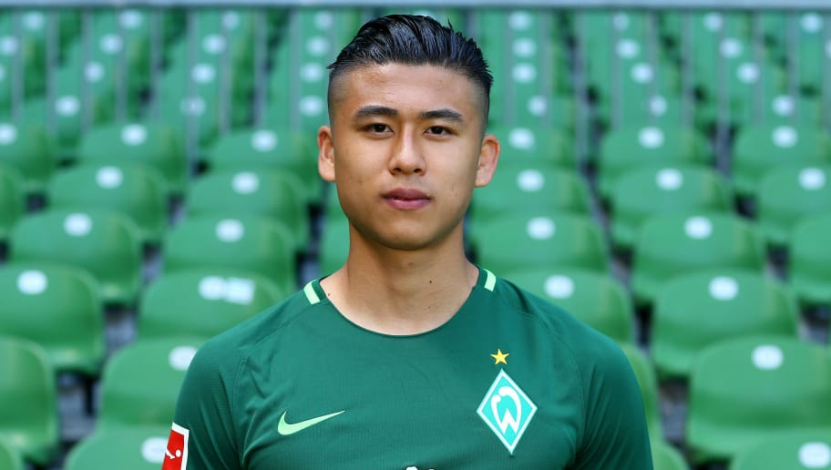 BREMEN, GERMANY - JULY 19:  Yuning Zhang of Werder Bremen poses during the team presentation at Weser Stadium on July 19, 2017 in Bremen, Germany.  (Photo by Christof Koepsel/Bongarts/Getty Images)