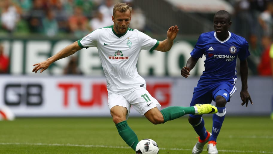 BREMEN, GERMANY - AUGUST 07: Lennart Thy of Bremen challenges N Golo Kante of Chelsea during the pre-season friendly match between Werder Bremen and FC Chelsea at Weserstadion on August 7, 2016 in Bremen, Germany. (Photo by Joachim Sielski/Bongarts/Getty Images)