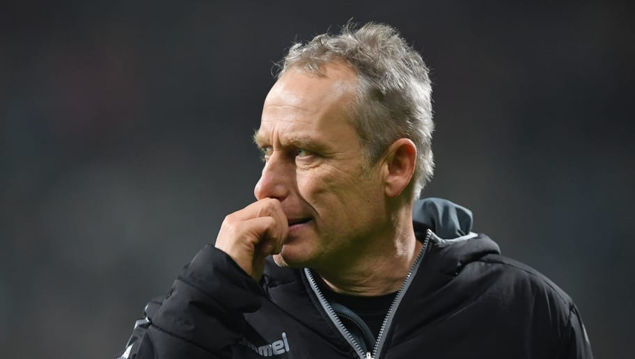 BREMEN, GERMANY - DECEMBER 20:  Christian Streich, head coach of Freiburg ponders during the DFB Cup match between Werder Bremen and SC Freiburg at Weserstadion on December 20, 2017 in Bremen, Germany.  (Photo by Stuart Franklin/Bongarts/Getty Images)