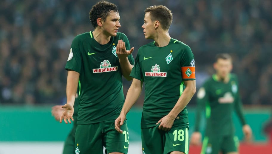 BREMEN, GERMANY - DECEMBER 20: Milos Veljkovic of Bremen speaks with Niklas Moisander of Bremen during the DFB Cup match between Werder Bremen and SC Freiburg at Weserstadion on December 20, 2017 in Bremen, Germany. (Photo by TF-Images/TF-Images via Getty Images)