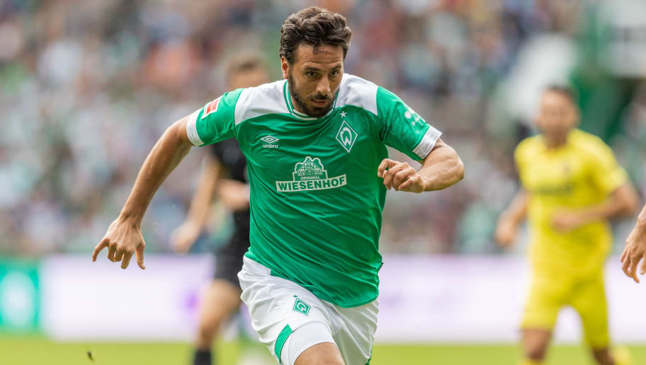BREMEN, GERMANY - AUGUST 11: Claudio Pizarro of Werder Bremen runs with the ball during the Pre Season Friendly Match between Werder Bremen and FC Villareal at Weserstadion on August 11, 2018 in Bremen, Germany. (Photo by Boris Streubel/Getty Images)