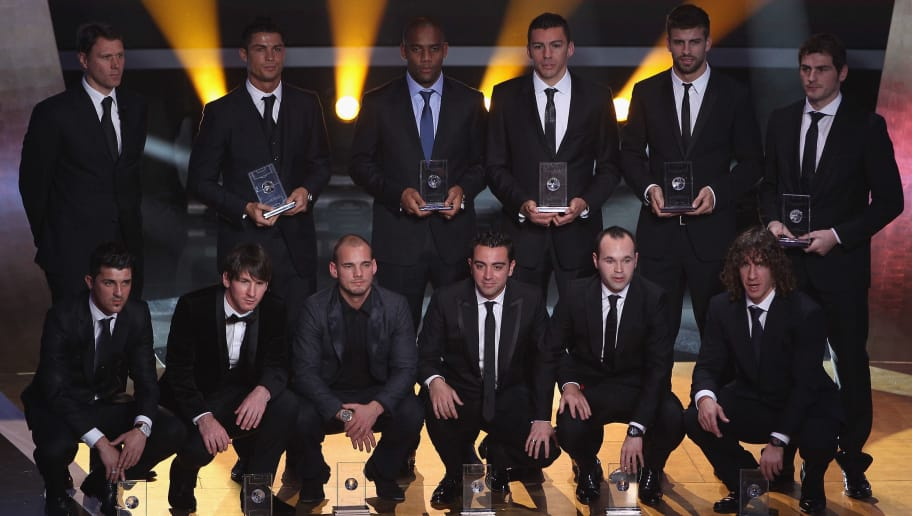 ZURICH, SWITZERLAND - JANUARY 10:  Fifa World XI award players back row l to r: Marco Van Basten who presented the award,Ronaldo,Maicon,Lucio,Gerard Pique,Iker Casillas, front row l to r: David Villa,Lionel Messi,Wesley Sneijder,Xavi,Andres Iniesta,Puyol during the FIFA Ballon d'or Gala at the Zurich Kongresshaus on January 10, 2011 in Zurich, Switzerland.  (Photo by Michael Steele/Getty Images)