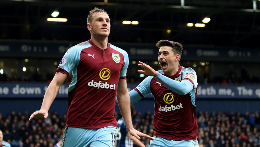 WEST BROMWICH, ENGLAND - MARCH 31:  Chris Wood of Burnley celebrates with teammate Matthew Lowton after scoring his sides second goal during the Premier League match between West Bromwich Albion and Burnley at The Hawthorns on March 31, 2018 in West Bromwich, England.  (Photo by Shaun Botterill/Getty Images)