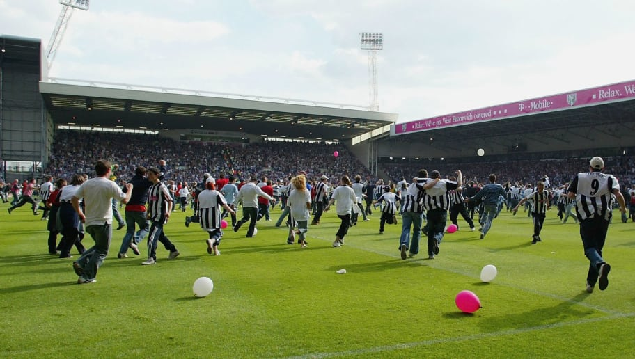 BIRMINGHAM, ENGLAND - MAY 15: WBA supporters celebrate at the end of the Barclays Premiership match between West Bromwich Albion and Portsmouth at The Hawthorns on May 15, 2005 in Birmingham, England.  (Photo by Julian Finney/Getty Images)