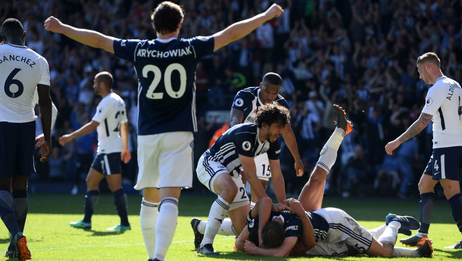 WEST BROMWICH, ENGLAND - MAY 05:  Jake Livermore of West Bromwich Albion (obscured) celebrates with teammates after scoring his sides first goal during the Premier League match between West Bromwich Albion and Tottenham Hotspur at The Hawthorns on May 5, 2018 in West Bromwich, England.  (Photo by Shaun Botterill/Getty Images)