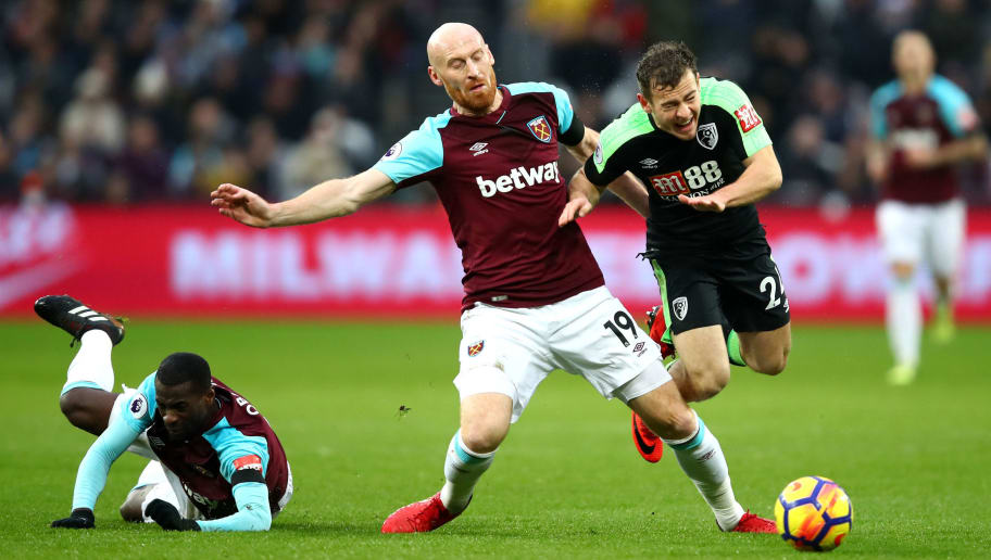 LONDON, ENGLAND - JANUARY 20: Ryan Fraser of AFC Bournemouth is fouled by James Collins of West Ham United during the Premier League match between West Ham United and AFC Bournemouth at London Stadium on January 20, 2018 in London, England.  (Photo by Julian Finney/Getty Images)