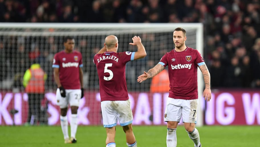 LONDON, ENGLAND - JANUARY 02:  Marko Arnautovic of West Ham United celebrates with teammate Pablo Zabaleta after scoring his team's second goal during the Premier League match between West Ham United and Brighton & Hove Albion at London Stadium on January 2, 2019 in London, United Kingdom.  (Photo by Justin Setterfield/Getty Images)
