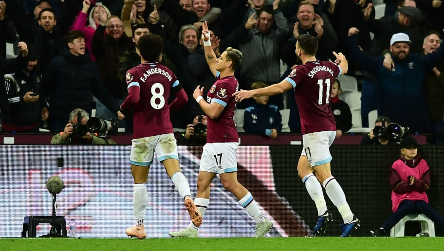LONDON, ENGLAND - NOVEMBER 03: Javier Hernandez of West Ham United celebrates after scoring his team's fourth goal with Felipe Anderson of West Ham United and Robert Snodgrass of West Ham United during the Premier League match between West Ham United and Burnley FC at London Stadium on November 3, 2018 in London, United Kingdom.  (Photo by Alex Broadway/Getty Images)