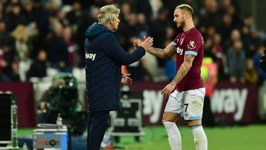 LONDON, ENGLAND - NOVEMBER 03: Manuel Pellegrini, Manager of West Ham United shakes hands with Marko Arnautovic of West Ham United as he is subbed during the Premier League match between West Ham United and Burnley FC at London Stadium on November 3, 2018 in London, United Kingdom.  (Photo by Alex Broadway/Getty Images)