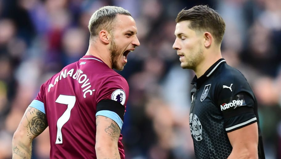LONDON, ENGLAND - NOVEMBER 03: Marko Arnautovic of West Ham United celebrates after scoring his team's first goal as James Tarkowski of Burnley reacts during the Premier League match between West Ham United and Burnley FC at London Stadium on November 3, 2018 in London, United Kingdom.  (Photo by Alex Broadway/Getty Images)