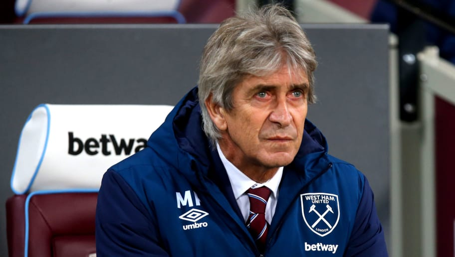 LONDON, ENGLAND - DECEMBER 04: Manager of West Ham Manuel Pellegrini looks on ahead of the Premier League match between West Ham United and Cardiff City FC at London Stadium on December 4, 2018 in London, United Kingdom. (Photo by Chloe Knott - Danehouse/Getty Images)