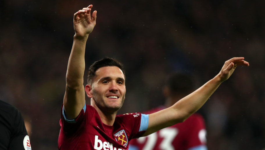 LONDON, ENGLAND - DECEMBER 04:  Lucas Perez of West Ham United celebrates after scoring his team's first goal during the Premier League match between West Ham United and Cardiff City at London Stadium on December 4, 2018 in London, United Kingdom.  (Photo by Dan Istitene/Getty Images)