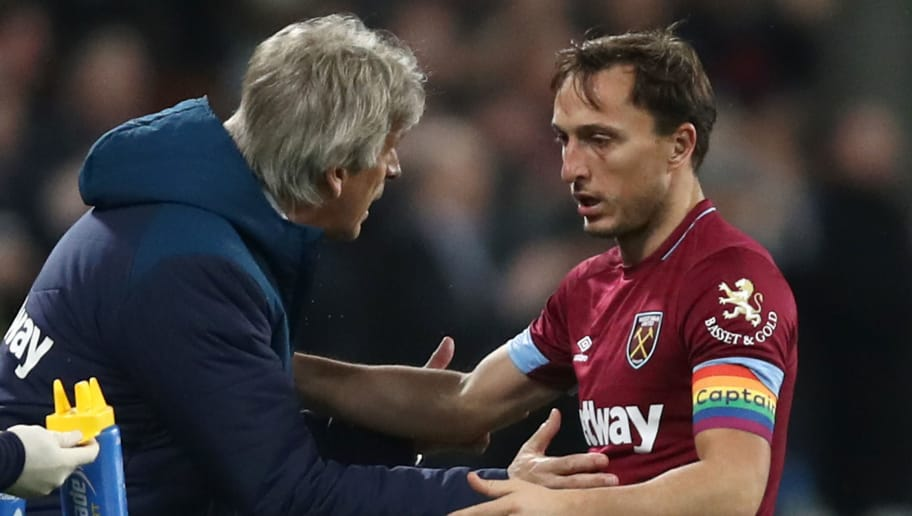 LONDON, ENGLAND - DECEMBER 04:  Mark Noble of West Ham United and Manuel Pellegrini, West Ham Head Coach speak during the Premier League match between West Ham United and Cardiff City at London Stadium on December 04, 2018 in London, United Kingdom. (Photo by Julian Finney/Getty Images)