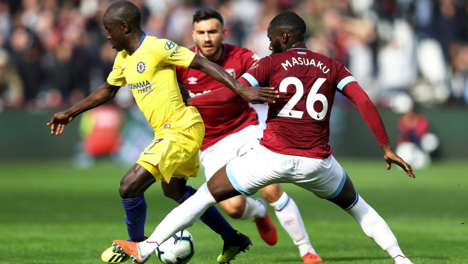 LONDON, ENGLAND - SEPTEMBER 23:  N'golo Kante of Chelsea battles for possession with Arthur Masuaku of West Ham United during the Premier League match between West Ham United and Chelsea FC at London Stadium on September 23, 2018 in London, United Kingdom.  (Photo by Dan Istitene/Getty Images)