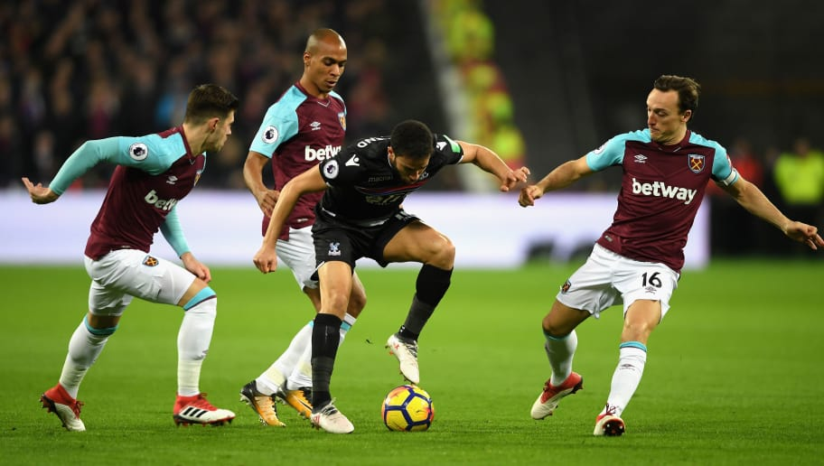LONDON, ENGLAND - JANUARY 30:  Andros Townsend of Crystal Palace is surrounded by Aaron Cresswell, Joao Mario and Mark Noble of West Ham United uring the Premier League match between West Ham United and Crystal Palace at London Stadium on January 30, 2018 in London, England.  (Photo by Mike Hewitt/Getty Images)