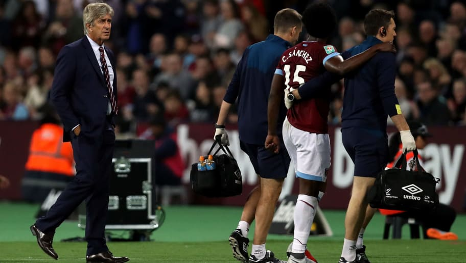 LONDON, ENGLAND - SEPTEMBER 26:  Carlos Sanchez of West Ham United goes off with an injury  during the Carabao Cup Third Round match between West Ham United and Macclesfield Town at The London Stadium on September 26, 2018 in London, England.  (Photo by Dan Istitene/Getty Images)