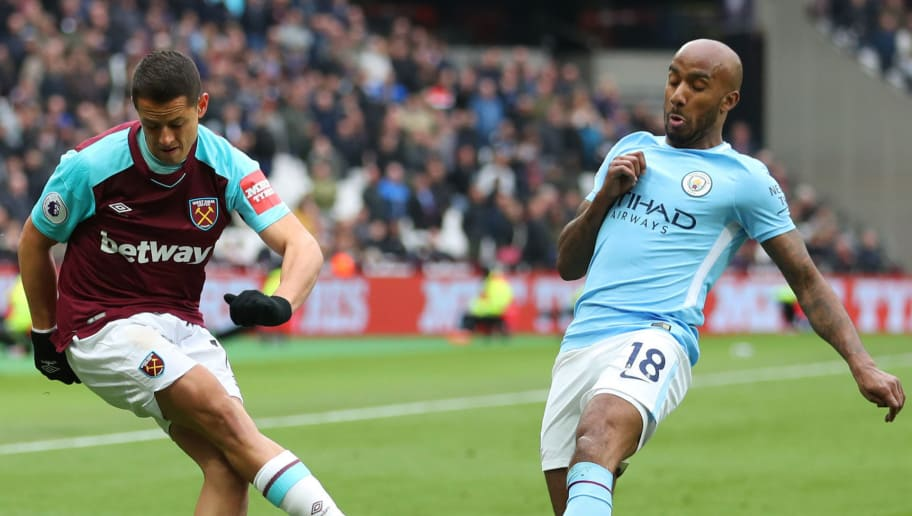 LONDON, ENGLAND - APRIL 29: Javier Hernandez of West Ham United is challenged by Fabian Delph of Manchester City during the Premier League match between West Ham United and Manchester City at London Stadium on April 29, 2018 in London, England.  (Photo by Catherine Ivill/Getty Images)