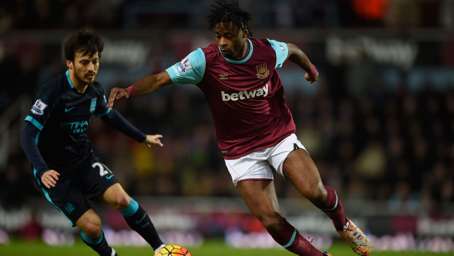 LONDON, ENGLAND - JANUARY 23:  Alexandre Song of West Ham United is challenged by David Silva of Manchester City during the Barclays Premier League match between West Ham United and Manchester City at Boleyn Ground in London, England.  (Photo by Mike Hewitt/Getty Images)