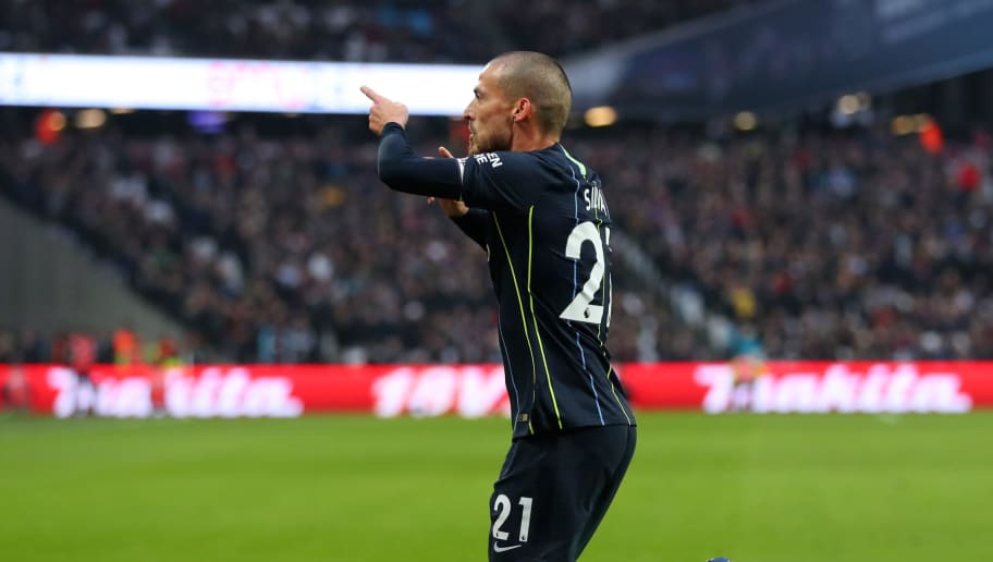 LONDON, ENGLAND - NOVEMBER 24:  David Silva of Manchester City celebrates after scoring his team's first goal during the Premier League match between West Ham United and Manchester City at London Stadium on November 24, 2018 in London, United Kingdom.  (Photo by Catherine Ivill/Getty Images)