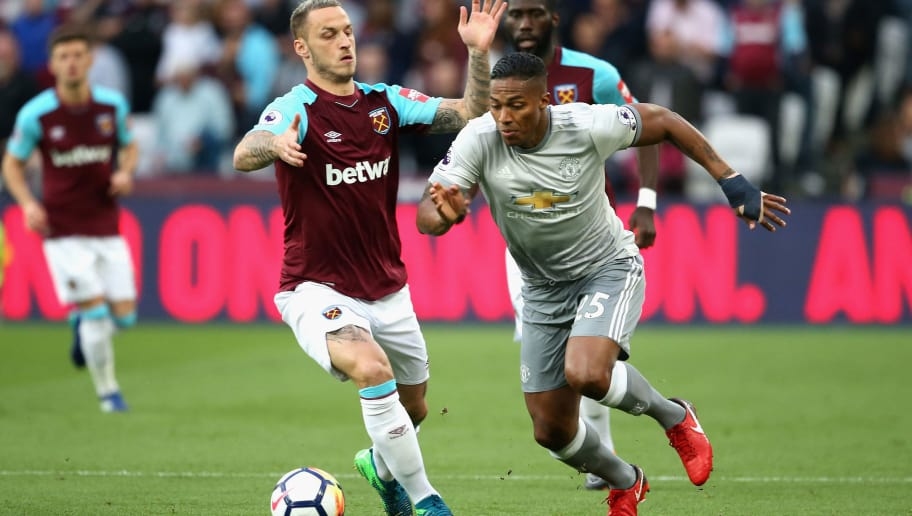 LONDON, ENGLAND - MAY 10:  Antonio Valencia of Manchester United goes past Marko Arnautovic of West Ham United  during the Premier League match between West Ham United and Manchester United at London Stadium on May 10, 2018 in London, England.  (Photo by Alex Pantling/Getty Images)