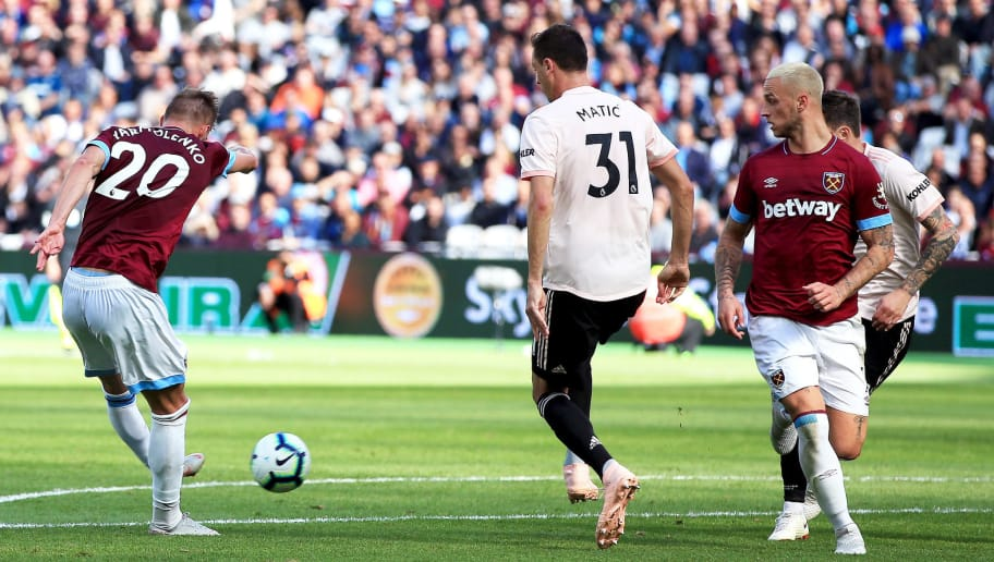 LONDON, ENGLAND - SEPTEMBER 29:  Andriy Yarmolenko of West Ham United shot at goal is deflected of Nemanja Matic of Manchester United for the second West Ham United goal during the Premier League match between West Ham United and Manchester United at London Stadium on September 29, 2018 in London, United Kingdom.  (Photo by Marc Atkins/Getty Images)