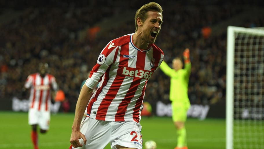 LONDON, ENGLAND - APRIL 16:  Peter Crouch of Stoke City celebrates scoring his sides first goal during the Premier League match between West Ham United and Stoke City at London Stadium on April 16, 2018 in London, England.  (Photo by Mike Hewitt/Getty Images)