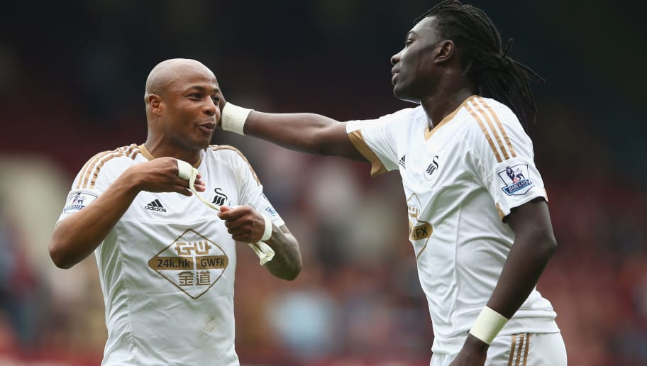 LONDON, ENGLAND - MAY 07:  Bafetimbi Gomis of Swansea talks to Andre Ayew of Swansea during the Barclays Premier League match between West Ham United and Swansea City at the Boleyn Ground, May 7, 2016, London, England.  (Photo by Paul Gilham/Getty Images)