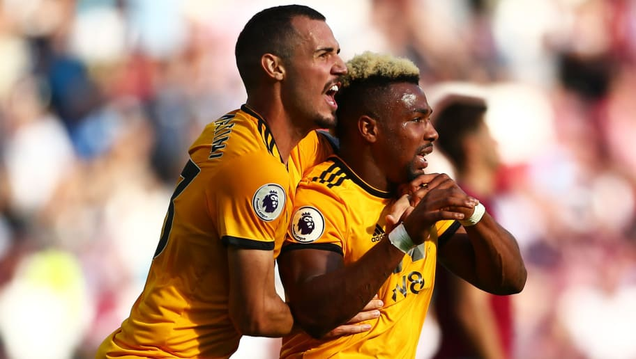 LONDON, ENGLAND - SEPTEMBER 01:  Adama Traore of Wolverhampton Wanderers celebrates with teammate Leo Bonatini after scoring his team's first goal during the Premier League match between West Ham United and Wolverhampton Wanderers at London Stadium on September 1, 2018 in London, United Kingdom.  (Photo by Jordan Mansfield/Getty Images)