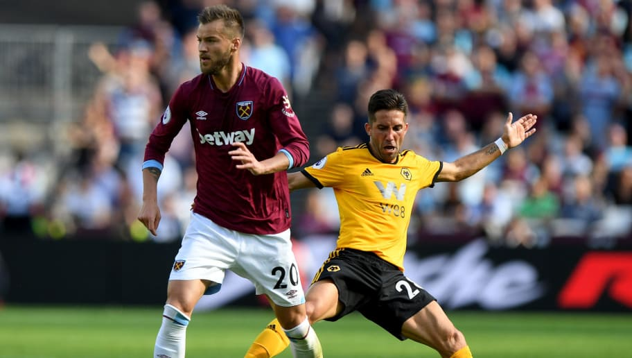 LONDON, ENGLAND - SEPTEMBER 01: Andriy Yarmolenko of West Ham United and Joao Moutinho of Wolverhampton Wanderers during the Premier League match between West Ham United and Wolverhampton Wanderers at London Stadium on September 1, 2018 in London, United Kingdom. (Photo by Sam Bagnall - AMA/Getty Images)