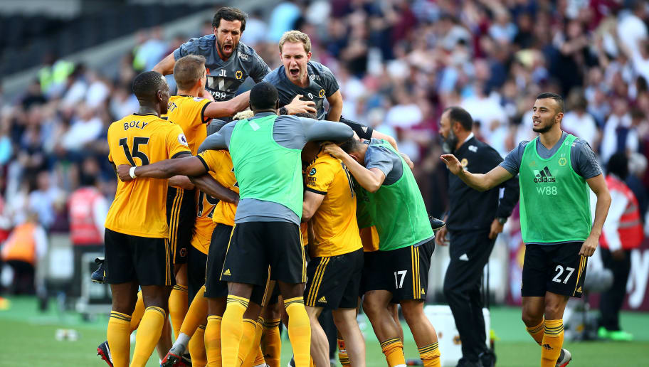 LONDON, ENGLAND - SEPTEMBER 01:  Adama Traore of Wolverhampton Wanderers celebrates with teammates and staff after scoring his team's first goal during the Premier League match between West Ham United and Wolverhampton Wanderers at London Stadium on September 1, 2018 in London, United Kingdom.  (Photo by Jordan Mansfield/Getty Images)