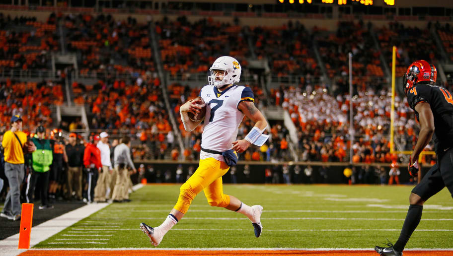 STILLWATER, OK - NOVEMBER 17:  Quarterback Will Grier #7 of the West Virginia Mountaineers scores a touchdown untouched against the Oklahoma State Cowboys in the fourth quarter on November 17, 2018 at Boone Pickens Stadium in Stillwater, Oklahoma.  Oklahoma State upset West Virginia 45-41.  (Photo by Brian Bahr/Getty Images)