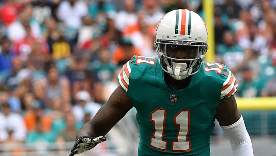 MIAMI, FL - DECEMBER 09: DeVante Parker #11 of the Miami Dolphins in action against the New England Patriots at Hard Rock Stadium on December 9, 2018 in Miami, Florida. (Photo by Mark Brown/Getty Images)