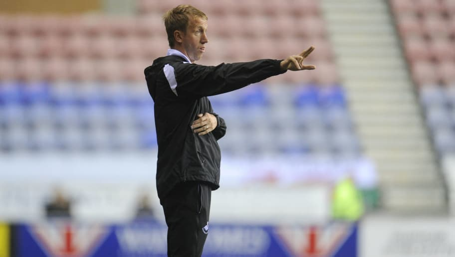 WIGAN, ENGLAND - OCTOBER 02: Graham Potter Manager of Swansea City shouts instructions to his team from the dug-out during the Sky Bet Championship match between Wigan Athletic and Swansea City at the Liberty Stadium on October 02, 2018 in Wigan, England. (Photo by Athena Pictures/Getty Images)
