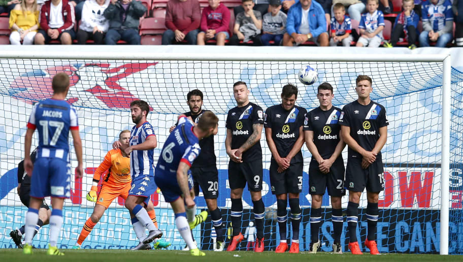 WIGAN, ENGLAND - AUGUST 13:  Max Power of Wigan Athletic takes a penalty kick during the Sky Bet Championship League match between Wigan Athletic and Blackburn Rovers at DW Stadium on August 13, 2016 in Wigan, England.  (Photo by Daniel Smith/Getty Images)