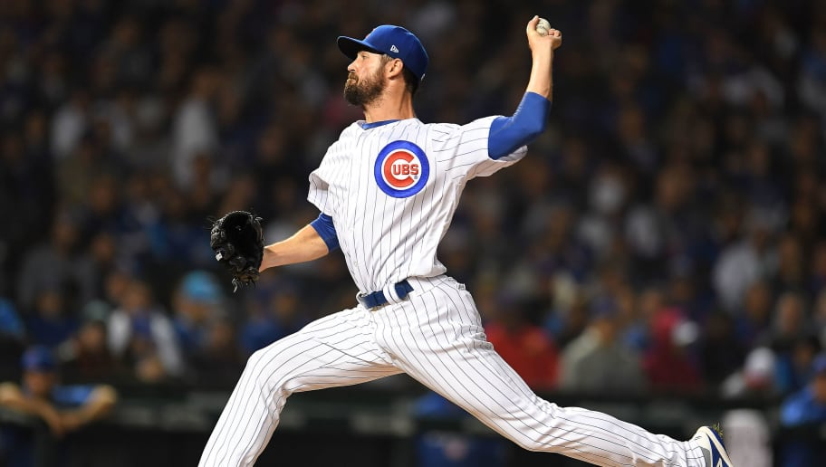 CHICAGO, IL - OCTOBER 02:  Cole Hamels #35 of the Chicago Cubs throws a pitch during the National League Wild Card game against the Colorado Rockies at Wrigley Field on October 2, 2018 in Chicago, Illinois.  The Rockies defeated the Cubs 2-1 in 13 innings.  (Photo by Stacy Revere/Getty Images)