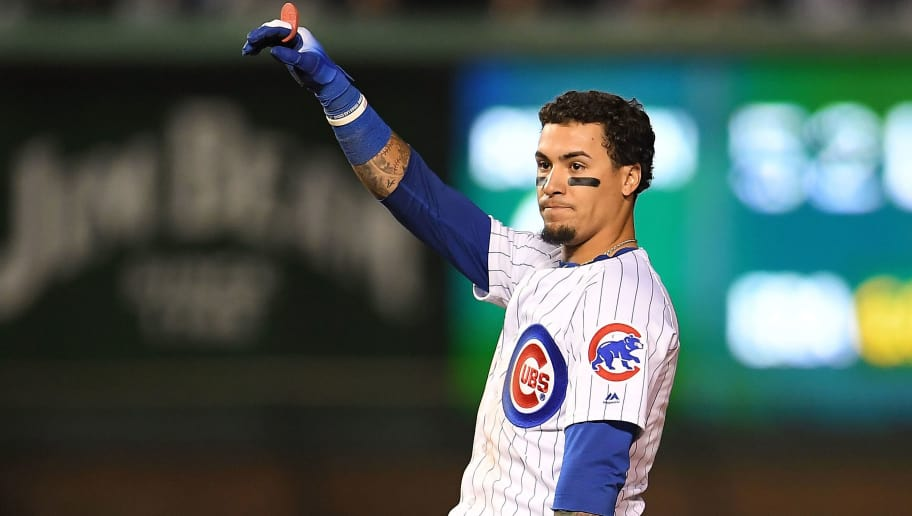 CHICAGO, IL - OCTOBER 02:  Javier Baez #9 of the Chicago Cubs hits a double during the National League Wild Card game against the Colorado Rockies at Wrigley Field on October 2, 2018 in Chicago, Illinois.  The Rockies defeated the Cubs 2-1 in 13 innings.  (Photo by Stacy Revere/Getty Images)