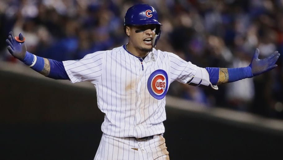 CHICAGO, IL - OCTOBER 02:  Javier Baez #9 of the Chicago Cubs celebrates after hitting a RBI double in the eighth inning against the Colorado Rockies to score Terrance Gore #1 (not pictured) during the National League Wild Card Game at Wrigley Field on October 2, 2018 in Chicago, Illinois.  (Photo by Jonathan Daniel/Getty Images)