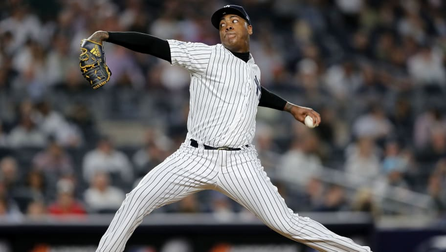 NEW YORK, NEW YORK - OCTOBER 03:  Aroldis Chapman #54 of the New York Yankees throws a pitch against the Oakland Athletics during the ninth inning in the American League Wild Card Game at Yankee Stadium on October 03, 2018 in the Bronx borough of New York City. (Photo by Elsa/Getty Images)