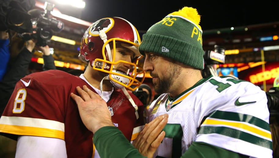 LANDOVER, MD - JANUARY 10: Quarterback Kirk Cousins #8 of the Washington Redskins greets quarterback Aaron Rodgers #12 of the Green Bay Packers after the Green Bay Packers defeated the Washington Redskins 35-18 during the NFC Wild Card Playoff game at FedExField on January 10, 2016 in Landover, Maryland. (Photo by Elsa/Getty Images)