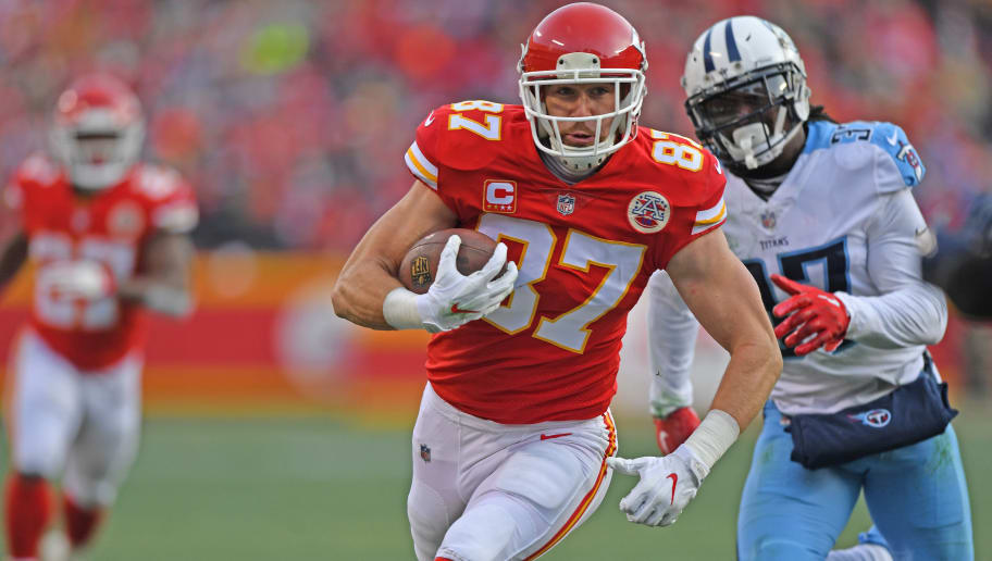 KANSAS CITY, MO - JANUARY 6:  Tight end Travis Kelce #87 of the Kansas City Chiefs runs up field after catching a pass against the Tennessee Titans during the first half of the game at Arrowhead Stadium on January 6, 2018 in Kansas City, Missouri. (Photo by Peter G. Aiken/Getty Images)