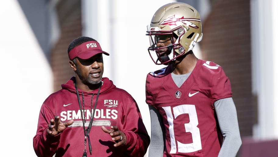 TALLAHASSEE, FL - MARCH 23: Head Coach Willie Taggart talks with Quarterback James Blackman #13 of the Florida State Seminoles during Spring Football Practice at the Albert J. Dunlap Athletic Training Facility on March 23, 2018 in Tallahassee, Florida. (Photo by Don Juan Moore/Getty Images)